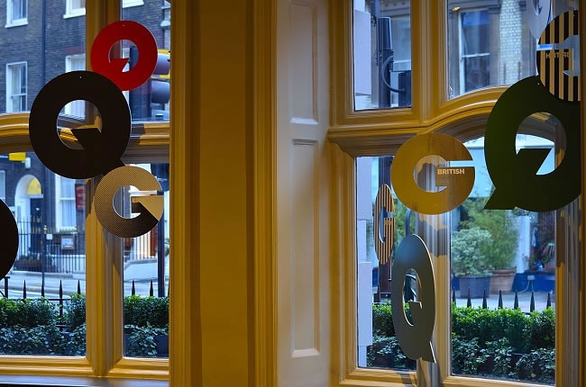 GQ branding in the lobby windows