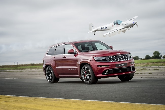 Jeep Grand Cherokee vs Aerobatic Twister Plane